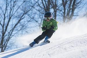 A boy on snow skiing